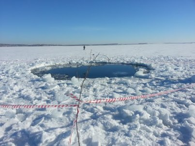 Chelyabinsk crater in frozen lake